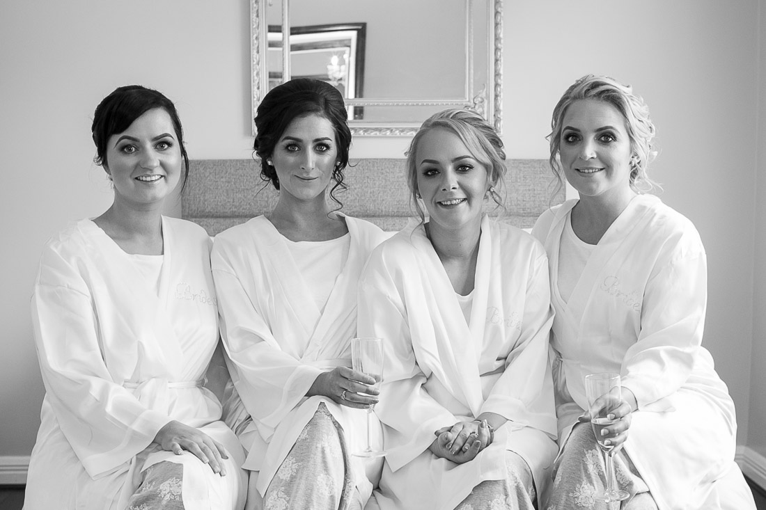 Four bridesmaids getting prepped